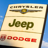 La rochelle, France - August 30, 2016: Official dealership sign of Chrysler, Jeep, and Dodge against the blue sky. American brand Royalty Free Stock Photos