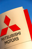 La rochelle, France - August 30, 2016: Official dealership sign of Mitsubishi against the blue sky. Mitsubishi Motors Corporation Royalty Free Stock Photos