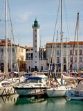 Harbor of La Rochelle on the Bay of Biscay, France. LA ROCHELLE, FRANCE - MARCH 29, 2017: Boats and yachts at the Harbor of La Rochelle, the French city and Stock Images