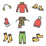 La ropa colorida del invierno del garabato fijó aislado en el fondo blanco Fotografía de archivo