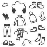 La ropa del invierno del garabato fijó aislado en el fondo blanco Imagen de archivo