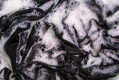 Ropa negra que se lava Fotografía de archivo libre de regalías