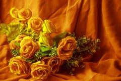 La rose orange, la beauté de l'humain Photo stock