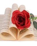 La rose sur des carnets avec des notes Images libres de droits