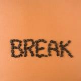 La rotura de la palabra deletreada hacia fuera en habas Imagen de archivo libre de regalías