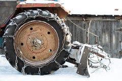 La roue d'hiver avec la chaîne Photographie stock libre de droits