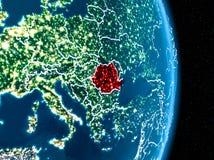 La Roumanie en rouge la nuit Photographie stock libre de droits