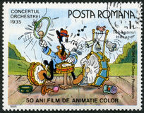 La ROUMANIE - 1986 : expositions Horace, caractères de Walt Disney dans la bande Concert, 1935, consacré cinquante ans de films an Photos stock