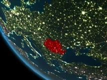 La Roumanie la nuit d'orbite Images libres de droits