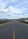 La route dans la prairie Photographie stock libre de droits