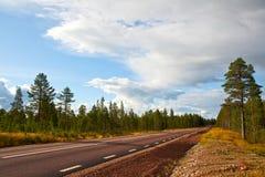 La route partant loin Images libres de droits