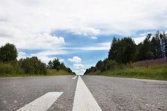 La route reculant dans la distance Photo libre de droits