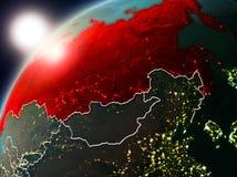 La Russie sur terre de planète dans le coucher du soleil Images libres de droits