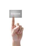 La réussite de main et de bouton a isolé Photo libre de droits