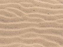 La sabbia increspa il fondo Immagini Stock