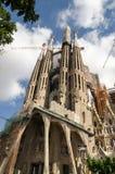 La Sagrada Familia by Antoni Gaudi, in Barcelona. La Sagrada Familia, designed by Antoni Gaudi, in Barcelona, with construction cranes showing behind Royalty Free Stock Image