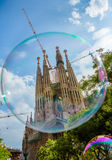 La Sagrada Familia behind Bubble. La Sagrada Familia - the cathedral designed by Gaudi, began construction in March 1882 and is still under construction as of Stock Photo