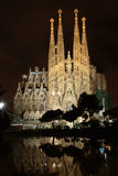 La Sagrada Familia at night. BARCELONA, SPAIN - MAY 10: The Basilica of La Sagrada Familia at night. Designed by Antoni Gaudi, its construction began in 1882 and Royalty Free Stock Photos