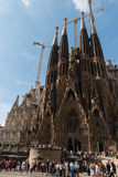 La Sagrada Familla. The church named La Sagrada Familla projected by the famous architect Antoni Gaudi, with a lot of visitors waiting for entering royalty free stock image