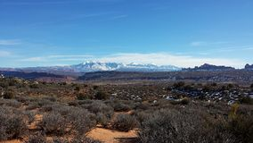 La Sal Mountain Snow-Capped Peaks and Redrock Seen From Arches National Park Moab Utah. La Sal Mountain Snow-Capped Peaks Seen From Arches National Park Moab royalty free stock photography