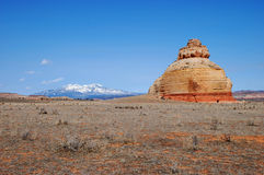 La Sal Mountains and the lonely Church rock Royalty Free Stock Photo