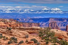 La Sal Mountains and Mesa Arch. Canyonlands National Park. Moab. United States royalty free stock image