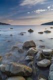 La salida del sol, isla de reflexiona sobre, Escocia Imagen de archivo libre de regalías
