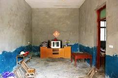 La salle de séjour de la maison d'un fermier Photographie stock