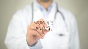 La salute delle donne, scrittura di medico sullo schermo trasparente Fotografia Stock Libera da Diritti