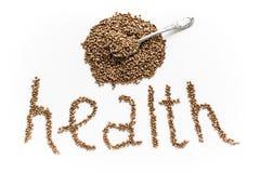 La salute di parola fatta dei grani del grano saraceno isolati su un fondo bianco Fotografia Stock Libera da Diritti