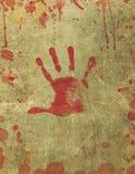 La sangre sangrienta de la impresión de la mano salpicó el fondo Imágenes de archivo libres de regalías