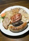 La saucisse frite typique de boudin de la Slovénie de nourriture a séché le cho de porc Image stock
