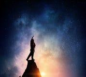 La scalata estrema è la sua adrenalina Media misti Fotografia Stock