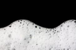 La schiuma bolle fondo nero astratto Fotografie Stock Libere da Diritti