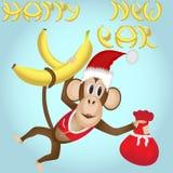 La scimmia con le banane durante i nuovi anni si veste con una borsa dei regali Immagine Stock