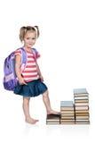 La scolara cammina i punti dei libri Fotografia Stock Libera da Diritti