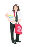La scolara con un sacchetto rosso Immagini Stock