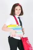 La scolara con un sacchetto rosso Immagine Stock