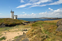 La Scozia, baia vermiglia, faro Fotografia Stock
