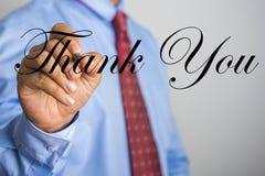 La scrittura dell'uomo d'affari vi ringrazia esprimere sullo schermo virtuale Fotografia Stock Libera da Diritti