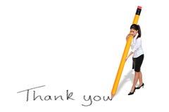 La scrittura della donna di affari lo ringrazia con la matita gigante Fotografie Stock