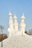 La scultura di neve - elevi sulla collina Fotografie Stock
