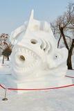 La scultura di neve - moto della neve Immagini Stock