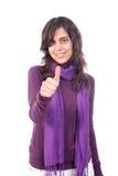 La señalización hermosa joven de la muchacha manosea con los dedos para arriba Imagen de archivo