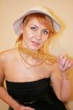 La señora en un sombrero Foto de archivo