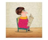 La señora está leyendo el periódico Foto de archivo libre de regalías