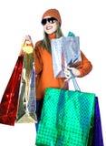 La señora joven con el regalo empaqueta (la Navidad/el cumpleaños) fotografía de archivo
