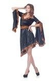 La señora joven en el vestido gris aislado en blanco Foto de archivo libre de regalías