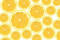 La section transversale du citron découpe le fond en tranches photo libre de droits