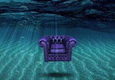 La sedia del bracciolo galleggia sopra il fondo del mare illustrazione vettoriale